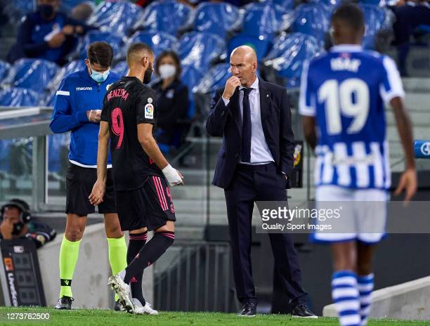 Zinedine Zidane head Coach and Karim Benzema of Real Madrid speaking during the La Liga Santader match between Real Sociedad and Real Madrid at...
