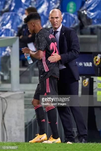 Zinedine Zidane head Coach and Marvin of Real Madrid talk during the La Liga Santader match between Real Sociedad and Real Madrid at Estadio Anoeta...