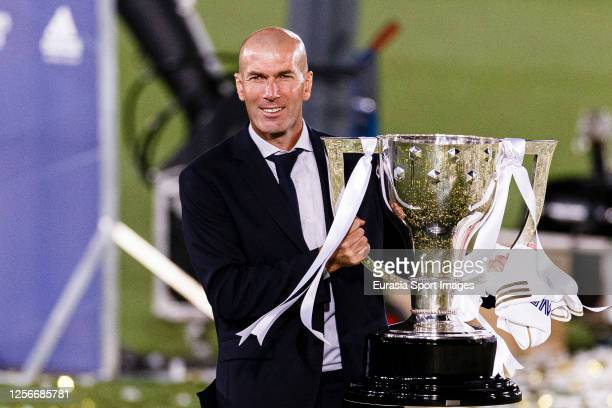 Zinedine Zidane head coach of Real Madrid celebrates with the La Liga trophy after the La Liga match between Real Madrid CF and Villarreal CF at...