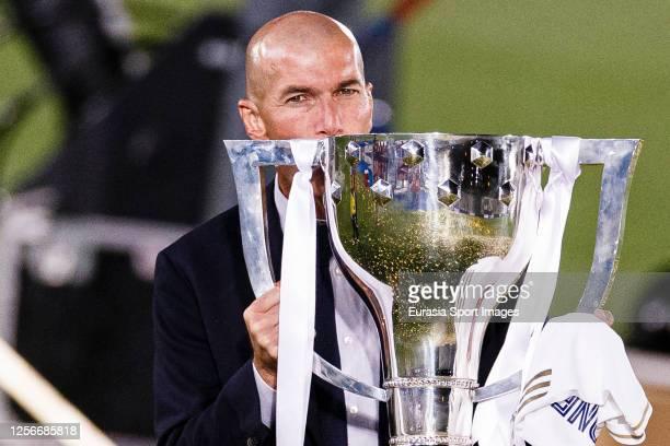 Zinedine Zidane head coach of Real Madrid celebrates with the La Liga trophy after the La Liga match between Real Madrid CF and Villarreal CF at...