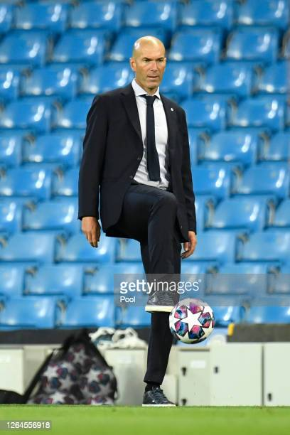 Zinedine Zidane Head Coach of Real Madrid controls the ball during the UEFA Champions League round of 16 second leg match between Manchester City and...