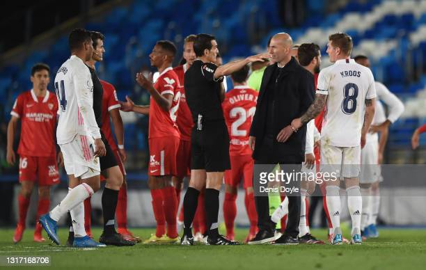 Zinedine Zidane, Head Coach of Real Madrid interacts with Referee Juan Martinez Munuera after the La Liga Santander match between Real Madrid and...