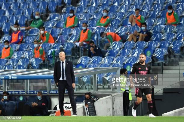 Zinedine Zidane Head Coach of Real Madrid looks on during the La Liga Santander match between Real Sociedad and Real Madrid at Estadio Anoeta on...