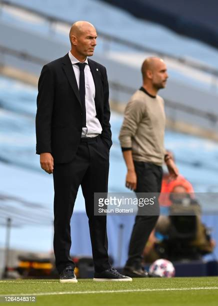 Zinedine Zidane Head Coach of Real Madrid looks on during the UEFA Champions League round of 16 second leg match between Manchester City and Real...