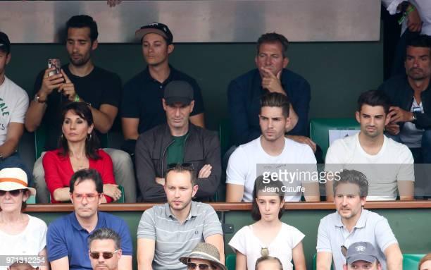 Zinedine Zidane his wife Veronique Zidane their sons Luca Zidane and Enzo Zidane above left Martin Fourcade attend the men's final during Day 15 of...
