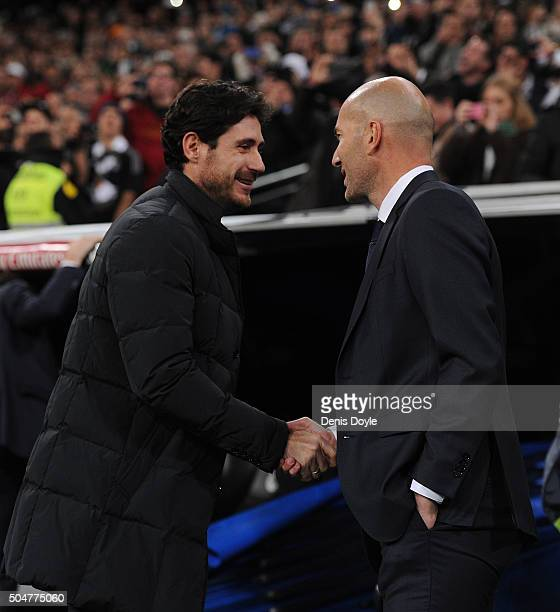 Zinedine Zidane manager of Real Madrid and Victor Sanchez del Amo manager of Deportivo La Coruna shake hands at the start of the La Liga match...