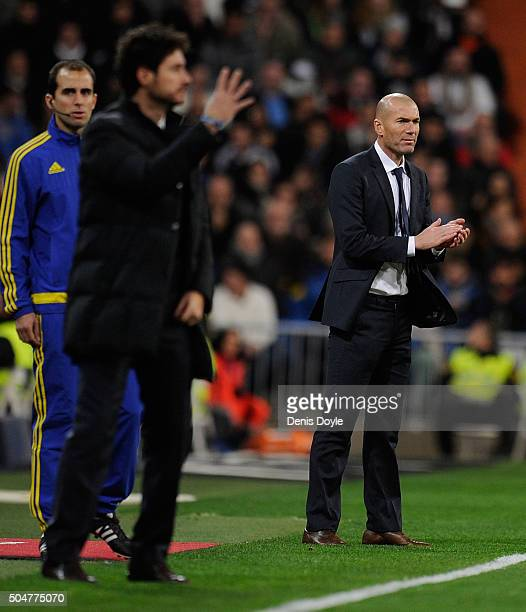 Zinedine Zidane manager of Real Madrid and Victor Sanchez del Amo manager of Deportivo La Coruna look on during the La Liga match between Real Madrid...