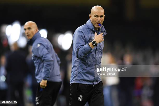 Zinedine Zidane Manager of Real Madrid blows a whistle during a Real Madrid training session prior to the UEFA Champions League Final between...