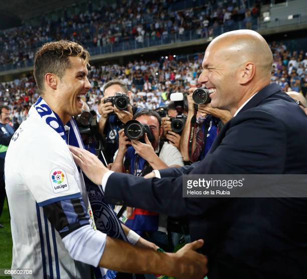 Zinedine Zidane Manager of Real Madrid celebrates with Cristiano Ronaldo of Real Madrid following the La Liga match between Malaga and Real Madrid at...