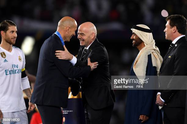 Zinedine Zidane Manager of Real Madrid celebrates with Gianni Infantino after the FIFA Club World Cup UAE 2017 Final between Gremio and Real Madrid...