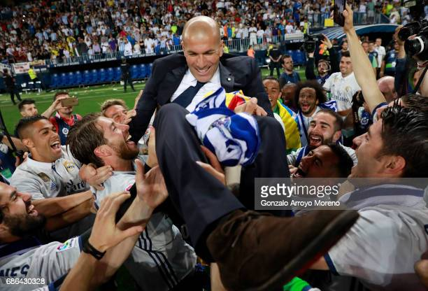 Zinedine Zidane Manager of Real Madrid celebrates with his players after being crowned champions following the La Liga match between Malaga and Real...