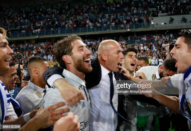 Zinedine Zidane Manager of Real Madrid celebrates with Sergio Ramos of Real Madrid after being crowned champions following the La Liga match between...