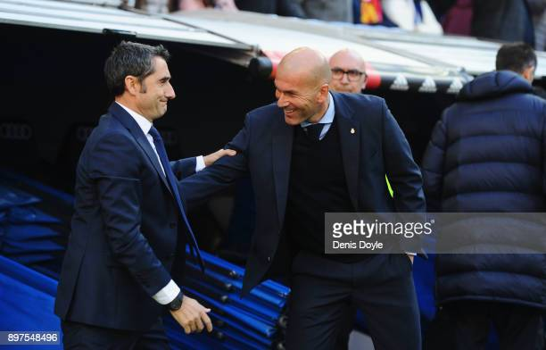 Zinedine Zidane, Manager of Real Madrid greets Ernesto Valverde, coach of Barcelona prior to the La Liga match between Real Madrid and Barcelona at...