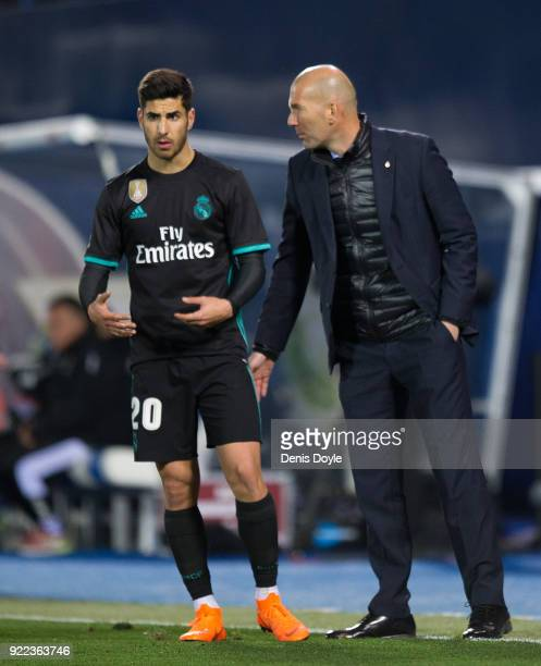 Zinedine Zidane Manager of Real Madrid has a word with Marco Asensio of Real Madrid during the La Liga match between Leganes and Real Madrid at...