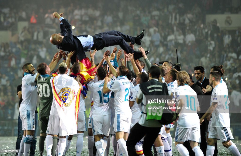 Zinedine Zidane, manager of Real Madrid is thrown in the air by his players during the Real Madrid team celebration after winning their 13th European Cup on May 27, 2018 in Madrid, Spain.