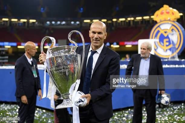 Zinedine Zidane, Manager of Real Madrid poses with the Champions League Trophy after the UEFA Champions League Final between Juventus and Real Madrid...