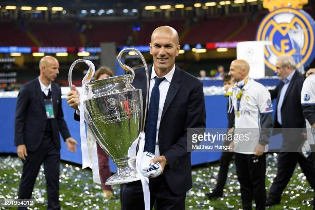 Zinedine Zidane Manager of Real Madrid poses with the Champions League Trophy after the UEFA Champions League Final between Juventus and Real Madrid...