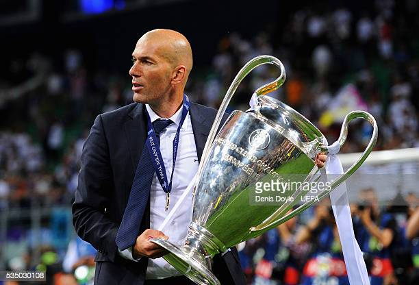 Zinedine Zidane manager of Real Madrid poses with the trophy after winning the UEFA Champions League Final between Real Madrid and Club Atletico de...