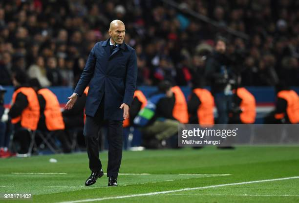 Zinedine Zidane Manager of Real Madrid reacts during the UEFA Champions League Round of 16 Second Leg match between Paris SaintGermain and Real...