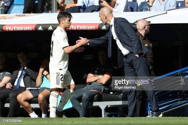 Zinedine Zidane, Manager of Real Madrid shakes hands with Brahim Diaz of Real Madrid during the La Liga match between Real Madrid CF and Villarreal...
