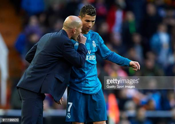 Zinedine Zidane Manager of Real Madrid speaks with Cristiano Ronaldo of Real Madrid during the La Liga match between Valencia and Real Madrid at...