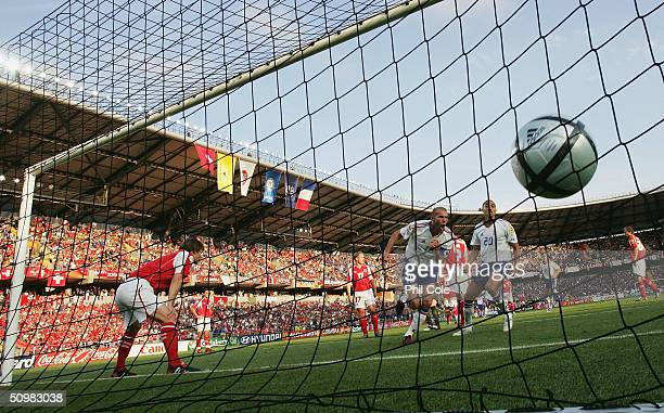 Zinedine Zidane of France celebrates scoring their first goal during the UEFA Euro 2004 Group B match between Switzerland and France at the Estadio...