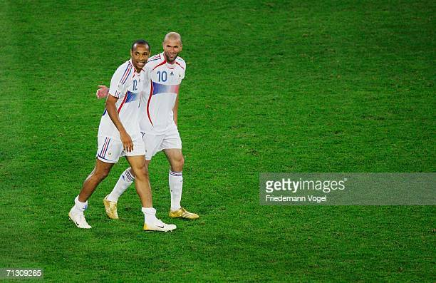 Zinedine Zidane of France celebrates victory with team mate Thierry Henry at the end of the FIFA World Cup Germany 2006 Round of 16 match between...