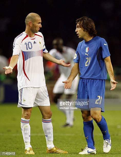 Zinedine Zidane of France exchanges words with Andrea Pirlo of Italy after headbutting Marco Materazzi of Italy in the chest during the FIFA World...