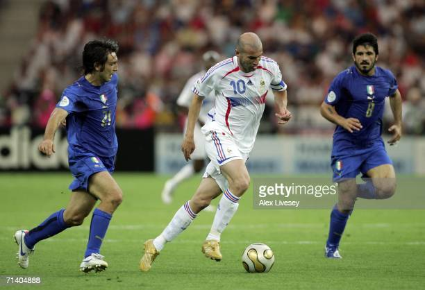 Zinedine Zidane of France goes past Andrea Pirlo and Gennaro Gattuso of Italy during the FIFA World Cup Germany 2006 Final match between Italy and...