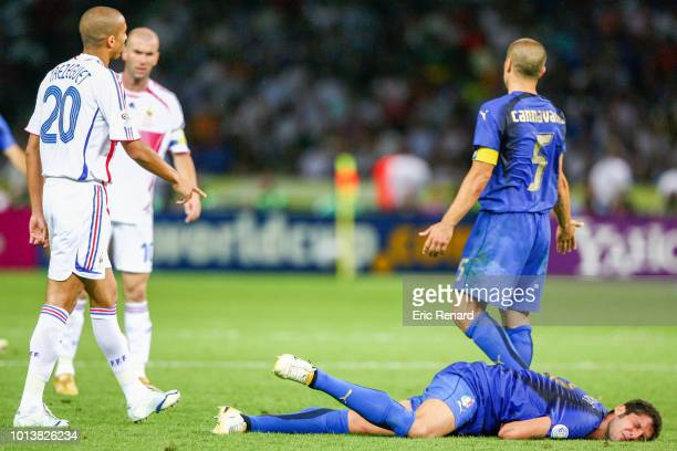 Zinedine Zidane of France hit Marco Materazzi of Italy during the World Cup final match between Italy and France at the Olympiastadion in Berlin,...