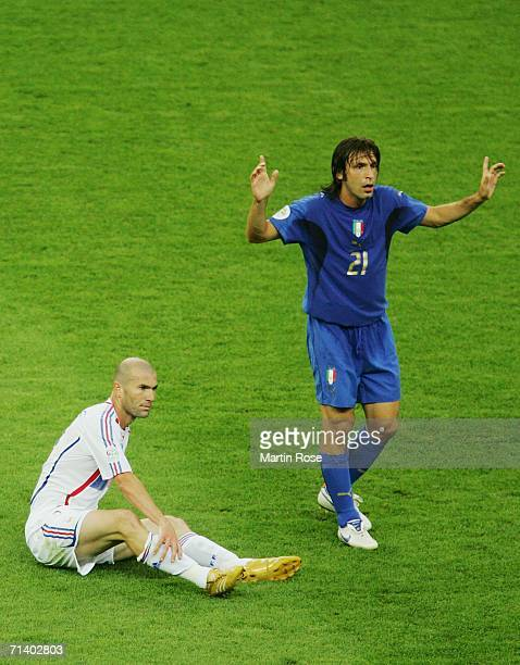Zinedine Zidane of France holds his leg as Andrea Pirlo of Italy gestures during the FIFA World Cup Germany 2006 Final match between Italy and France...
