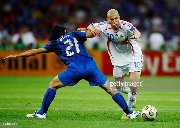 Zinedine Zidane of France is challenged by Andrea Pirlo of Italy during the FIFA World Cup Germany 2006 Final match between Italy and France at the...