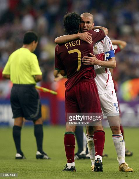 Zinedine Zidane of France is hugged by Luis Figo of Portugal following France's 10 victory during the FIFA World Cup Germany 2006 Semifinal match...