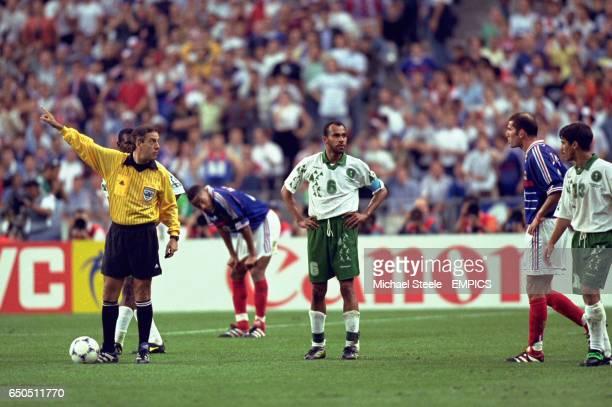 Zinedine Zidane of France is sent off by referee Arturo Brizio Carter