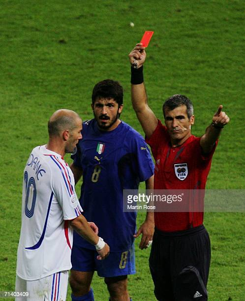 Zinedine Zidane of France is shown a red card by Referee Horacio Elizondo of Argentina as Gennaro Gattuso of Italy looks on during the FIFA World Cup...