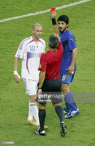 Zinedine Zidane of France is shown the red card by Referee Horacio Elizondo of Argentina as Gennaro Gattuso of Italy looks on during the FIFA World...