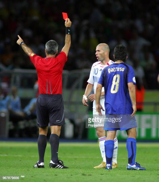 Zinedine Zidane of France is shown the Red Card by referee Horacio Elizondo for head butting an opponent, watched by Gennaro Gattuso of Italy ,...