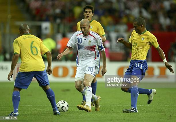 Zinedine Zidane of France is surrounded by Brazilian players during the FIFA World Cup Germany 2006 Quarterfinal match between Brazil and France at...