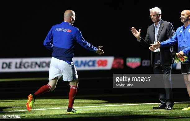 Zinedine Zidane of France react with Aime Jacquet and Fabien Barthez during the Friendly match between France 98 and FIFA 98 at U Arena on June 12...