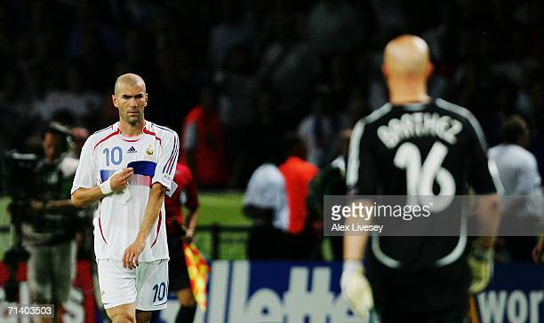 Zinedine Zidane of France removes his captains armband to give to teammate Fabien Barthez after being sent off during the FIFA World Cup Germany 2006...