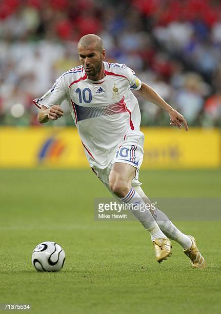 Zinedine Zidane of France runs with the ball during the FIFA World Cup Germany 2006 Semi-final match between Portugal and France at the Stadium...