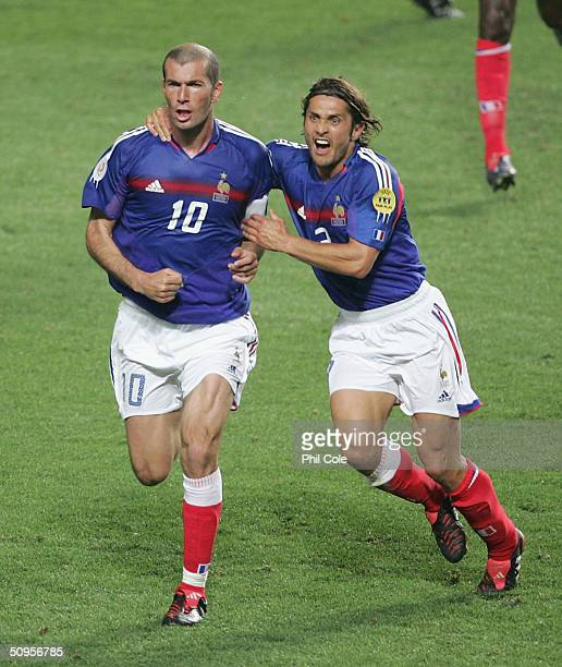 Zinedine Zidane of France Scores from the penalty and celabrates with Bixente Lizarazu during the France v England Group B match in the 2004 UEFA...