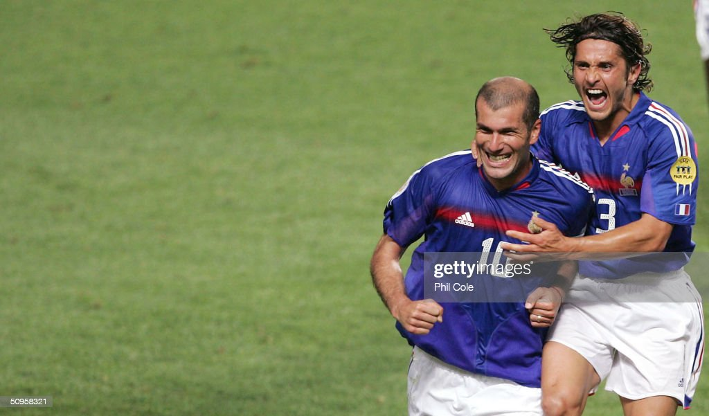 Zinedine Zidane of France Scores from the penalty and celabrates with Bixente Lizarazu during the France v England Group B match in the 2004 UEFA European Football Championships at the Estadio da Luz on June 13, 2004 in Lisbon, Portugal.