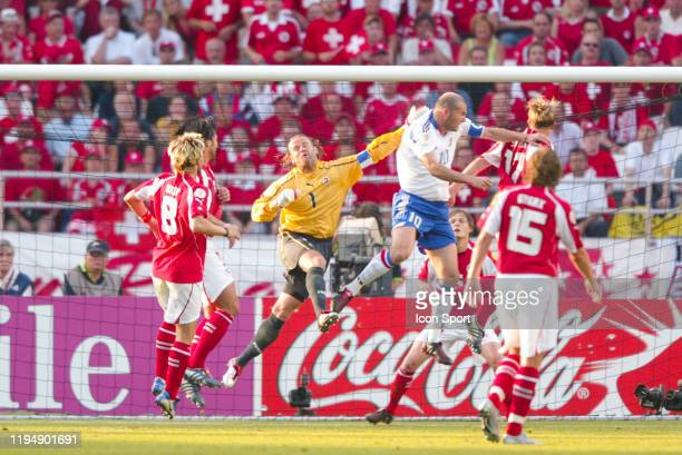 Zinedine ZIDANE of France scores his goal and Jorg STIEL of Switzerland wcan't stop it during the European Championship Pool B match between...