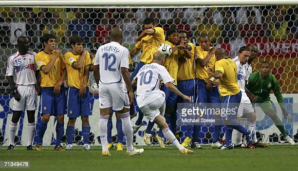 Zinedine Zidane of France strikes a free kick directly at the Brazilian wall during the FIFA World Cup Germany 2006 Quarterfinal match between Brazil...