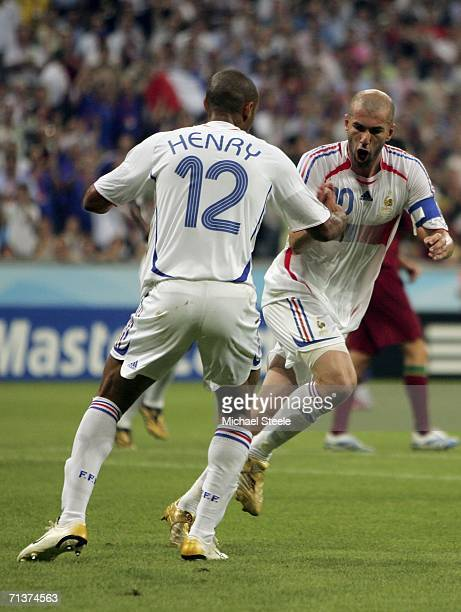 Zinedine Zidane of France turns away to celebrate with teammate Thierry Henry , after scoring the opening goal from the penalty spot during the FIFA...