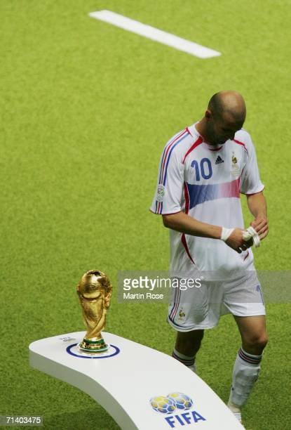 Zinedine Zidane of France walks past the World Cup trophy after being sent off during the FIFA World Cup Germany 2006 Final match between Italy and...