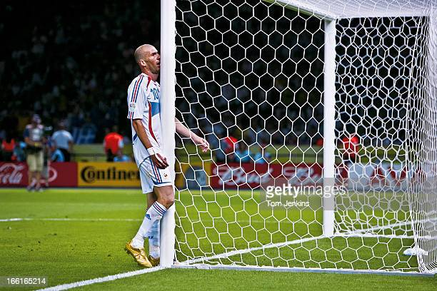 Zinedine Zidane of France walks straight into a goal-post as he shows frustration in extra-time during the 2006 FIFA World Cup Final France versus...