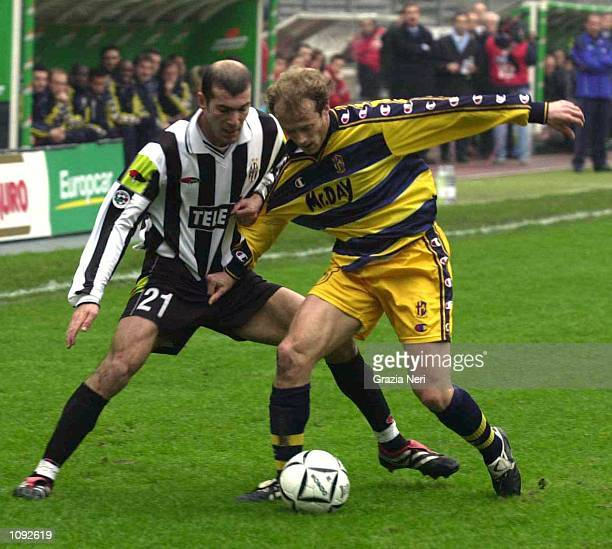 Zinedine Zidane of Juventus and Gianluca Falsini of Parma in action during the Serie A 10th Round League match between Juventus and Parma played at...
