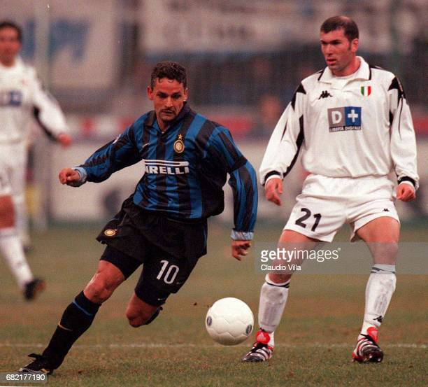 Zinedine Zidane of Juventus FC and Roberto Baggio of Inter compete for the ball during the Serie A match between INTER and JUVENTUS played at...